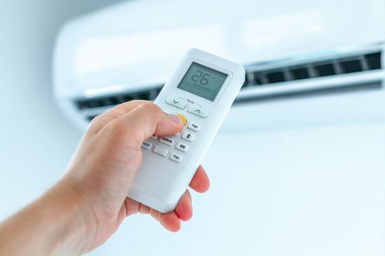 Air conditioner temperature adjustment with remote controller from heduschka at home.